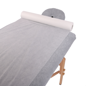 Obrazek Prześcieradło jednorazowe kosmetyczne Podkład na stół do masażu Prześcieradło z włókniny szerokość 60 cm długość 300 m gr 15/m2 bez perforacji kolor biały