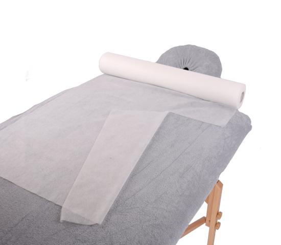 Obrazek Prześcieradło jednorazowe 30/100 m Podkład na stół do masażu Prześcieradło z włókniny szerokość 30 cm 100 m gr 15/m2 z perforacją co 39 cm kolor biały