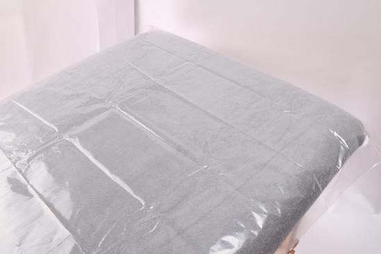 Obrazek Podkład z folii 200x220 cm Folia do zabiegów SPA 200x220 cm. Folia BODY WRAP bezbarwna. Prześcieradło jednorazowe z folii na stół do masażu fotel kosmetyczny Opakowanie 25 sztuk